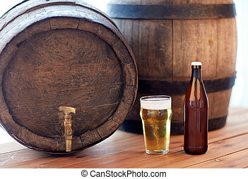 close up of old beer barrel, glass and bottle - brewery,...