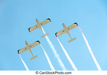 Airplanes on airshow - Three airplanes on airshow in...