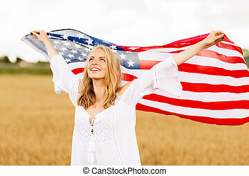 happy woman with american flag on cereal field - country,...