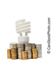 Energy Saving - Energy saving light bulb and stacks of coins...