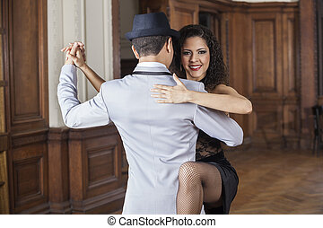 Happy Woman Performing With Male Tango Dancer