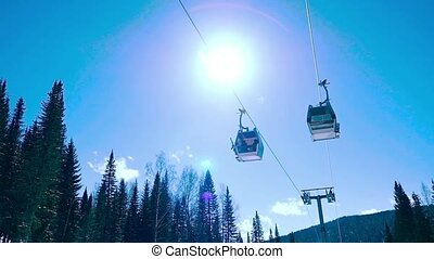 Ski cable cars on the sun and sky background in slowmotion...