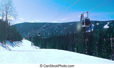 Ski cable cars on the sun and sky background in slowmotion....