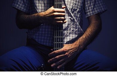 Bass Player and His Guitar - Hands of a bass player, closeup...