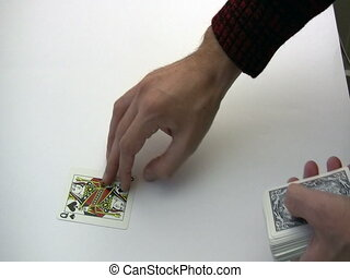 Cards - Croupier dealing playing cards with one card in the...