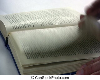 Book - thumbs turn the page of the book