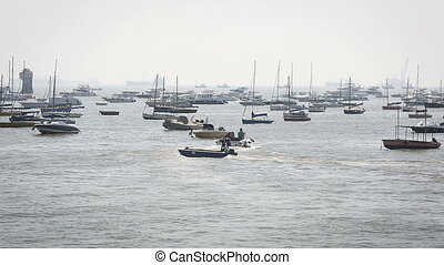 Tourist and fisher boats by the harbour in the summer
