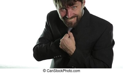 bearded man in a business suit gives a ring in the red box...