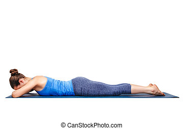 Woman relaxes in yoga asana Makarasana - Woman relaxes in...