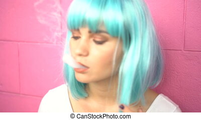 Sexy young girl in modern futuristic style with blue wig...