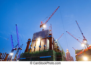 Brightly lit construction site - Construction at night with...