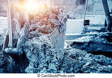 Working excavator, blue tone image. - Close-up of a...