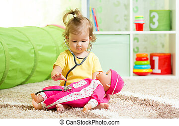 Kid Girl Playing With A Doll In Playroom