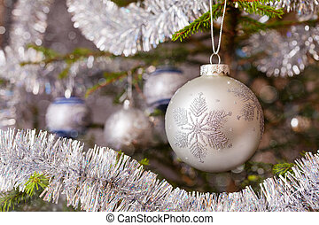 Decoration bauble on decorated Christmas tree - Christmas...