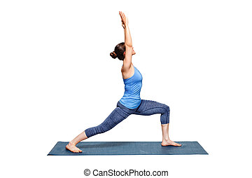 Sporty fit woman practices yoga asana utthita Virabhadras -...