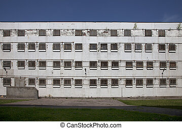 The windows of an abandoned prison - Building of abandoned...