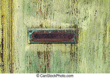 Vintage letterbox on wooden door