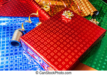Gift wrapped in red paper with golden ribbon