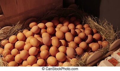 Chicken eggs in a basket - Beautifully packaged eggs in...