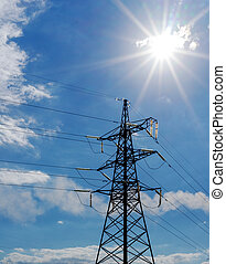 Power Line. pylon against a blue sky and sun.