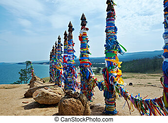 Serge - pillars on Olkhon island, lake Baikal, Siberia,...