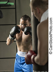 Training with heavy bag - Boxer training with heavy bag at...