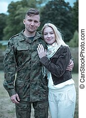 Supporting her husband soldier in his duties - Lovely...