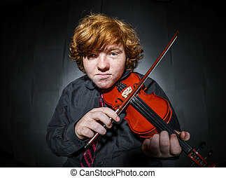 Freckled red-hair boy playing violin - Studio shooting...