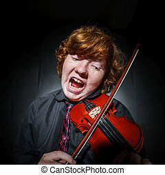 Freckled red-hair boy playing violin - Studio shooting....