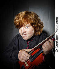 Studio shooting. - Freckled red-hair boy playing violin