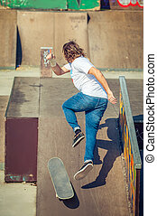 Young man riding skate at park and falling down - Young man...