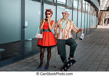 Old man saunters with a young girl. - Old man saunters with...