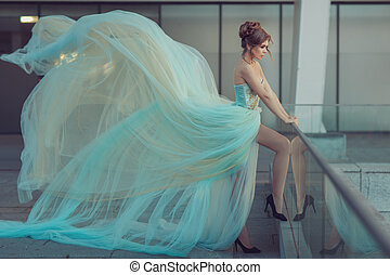 Very long dress on a girl - Beautiful girl standing on the...