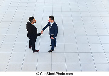 Businessmen Hand Shake Welcome Gesture Top Angle View, Two...