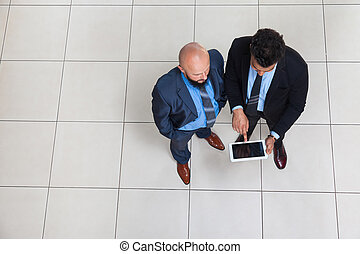 Businesspeople Working Using Tablet Computer, Two Business...