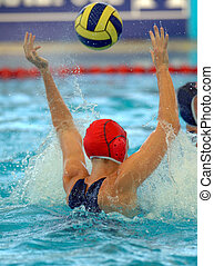 A female water polo goalie misses a shot