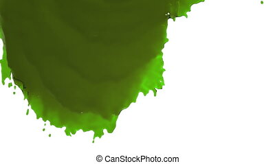 green paint flowing down slowly colored oil - close-up view...
