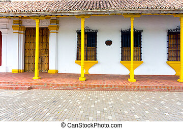 Yellow and White Colonial Architecture - Beautiful yellow...