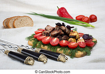 barbecue with fresh vegetables and bread