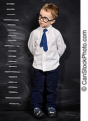 good growth - Four year old boy in white shirt and a tie...