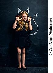 little imp - Funny little imp girl. Cute child girl posing...