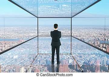 Thoughtful businessman in glass interior - Thoughtful...