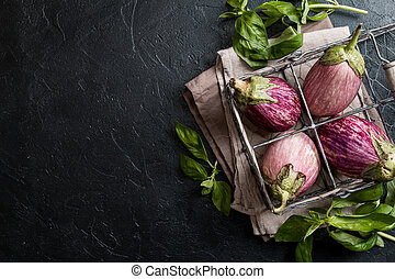 Fresh healthy eggplants on dark background, top view, copy...