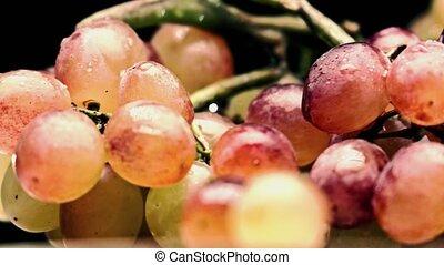 Mix color grape bunch, bleached colors. 4K closeup pan shot...