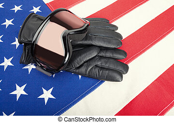 Goggles and gloves over US flag - studio shot - Winter sport...