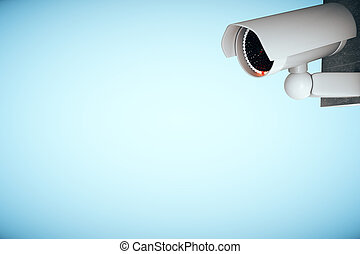 CCTV camera on blue background
