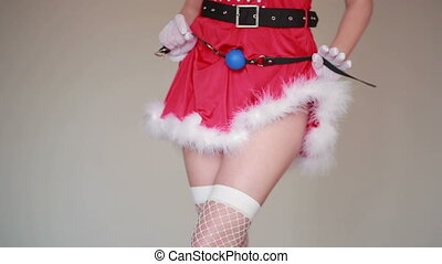 Sexy Santa Girl caresses herself. sex games. holding a whip...