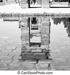 Temple of Debod in Madrid reflects in pond, Spain. Black and...