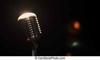 View of concert microphone stay on stage in empty club under...