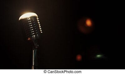 Concert vintage glowing microphone stay on stage in empty bar under spotlight